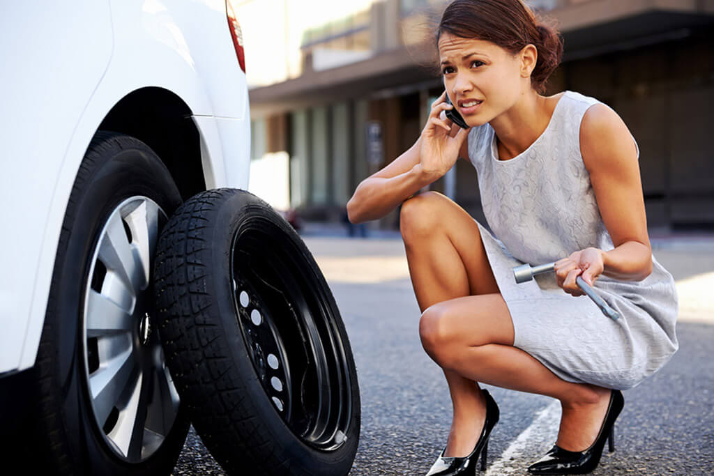 Women calling Towing Wilmington to help he with a tire repair or replacement.