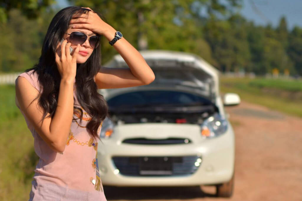 Women calling for 24 hour towing and assistance with a battery jump start.